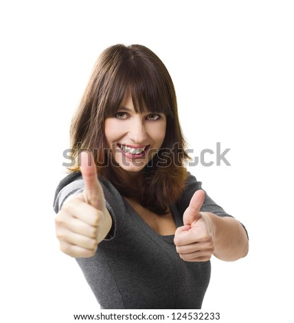 Beautiful young woman with thumbs up isolated on a white, focus is on the face