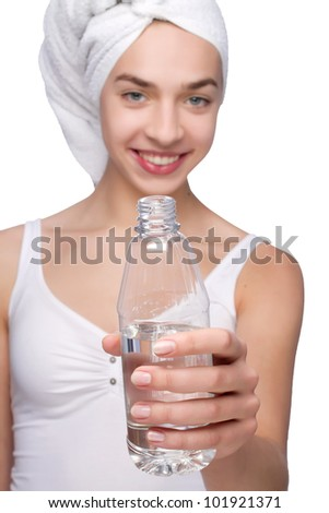 Beautiful young woman with towel on her head - stock photo