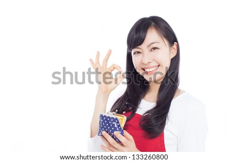 beautiful young woman with wallet showing OK sign, isolated on white background