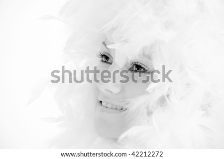 beautiful young woman with white feathers #42212272