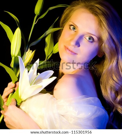 Beautiful young woman with white lily on background