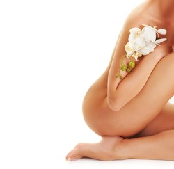 Beautiful young woman with white orchid