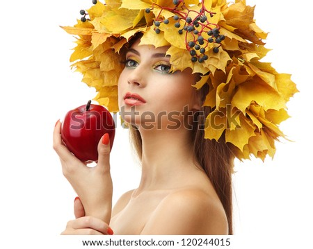 beautiful young woman with yellow autumn wreath and apple, isolated on white