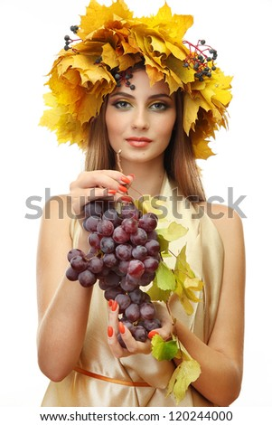 beautiful young woman with yellow autumn wreath and grapes, isolated on white