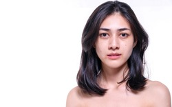 Beautiful young woman without make up on her face no retouch, fresh face while looking at camera on isolated white background. Facial treatment, cosmetic, spa, make up, beauty surgery clinic concept.