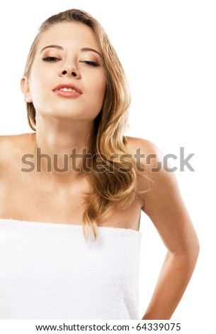 Beautiful young woman wrapped in the towel, white background