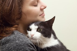 beautiful young woman 20 years  with monochrome black and white cat