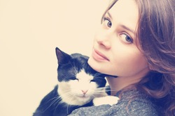 beautiful young woman 20 years  with monochrome black and white cat, with instagram effect