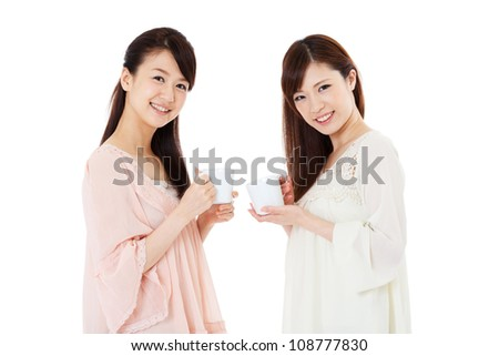 Beautiful young women drinking coffee. Portrait of asian.