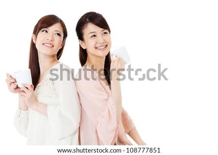 Beautiful young women drinking coffee. Portrait of asian.