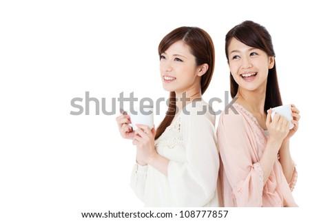 Beautiful young women drinking coffee. Portrait of asian. - stock photo