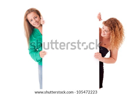 Beautiful young women holding a blank white board