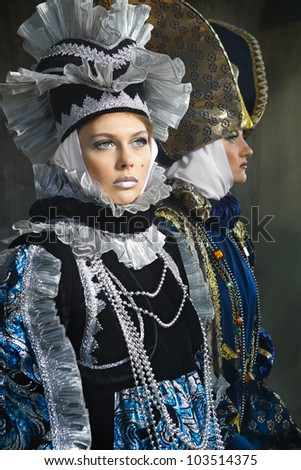 Beautiful young women in colorful stylized medieval costume