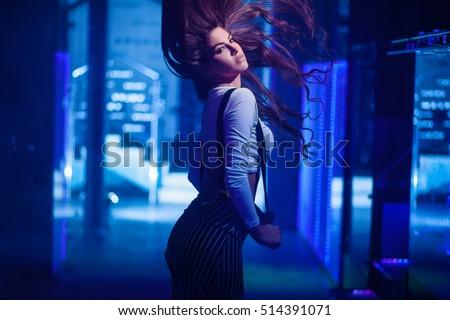 Beautiful young women posing in blue dress / Fashion