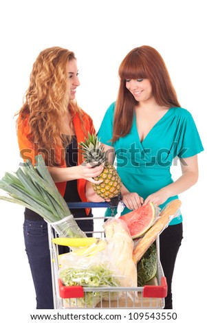 Beautiful young women shopping at the supermarket