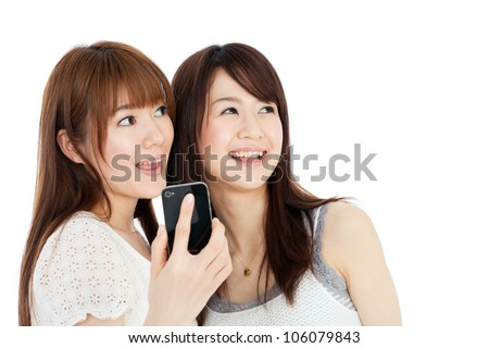 Beautiful young women using a mobile phone. Portrait of asian.