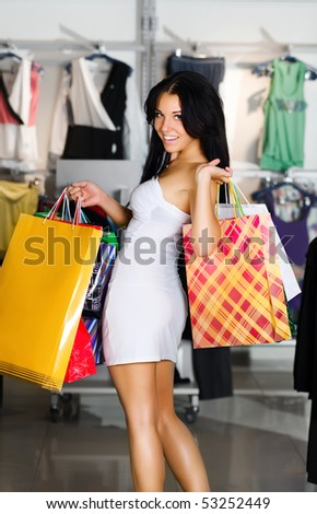 Beautiful young women with packages shopping