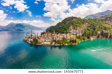 Beautifull aerial panoramic view from the drone to the Varenna - famous old Italy town on bank of Como lake. High top view to Water landscape with green hills, mountains and city in sunny summer day. #1450670771
