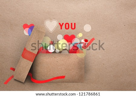 Beautifull natural paper applique Valentine greeting card with an open gift box emitting round part lights and the message Love you with a symbolic heart and copyspace