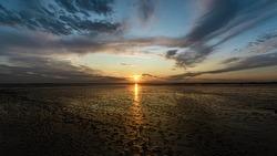 Beautifull sunset northsea goldenhour ebb