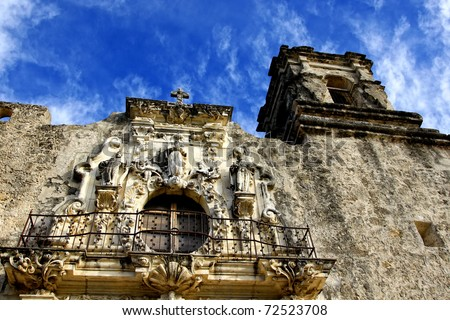 Beautifully carved front tower and balcony with statuary at the historic Mission San Jose, an eighteenth century Spanish Mission near San Antonio, Texas.
