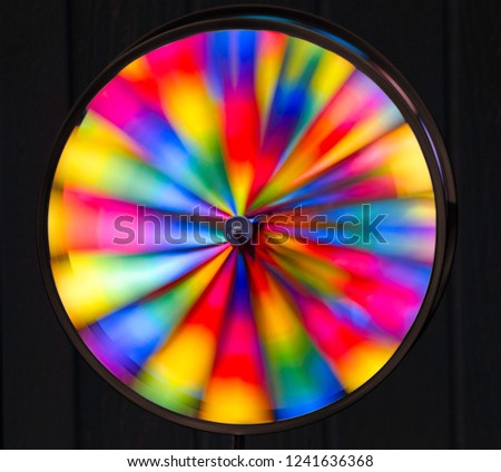 Beautifully Colorful Rainbow Pinwheel Captured Spinning in Motion - high speed blur #1241636368