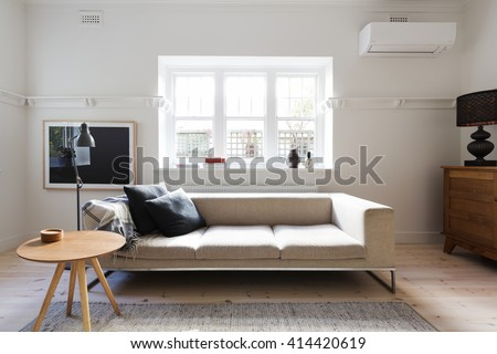 Beautifully Danish styled interior living room of sofa and coffee table in a renovated apartment