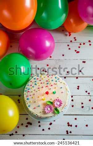 Beautifully decorated birthday cake with lighted candles