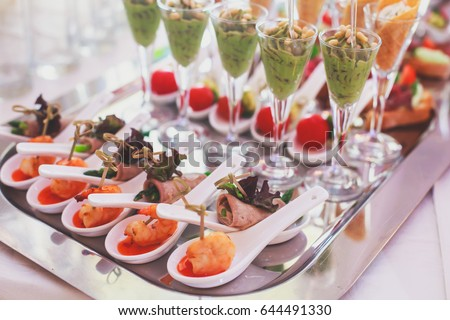 Beautifully decorated catering banquet table with different food snacks and appetizers on corporate christmas birthday party event or wedding celebration  - Shutterstock ID 644491330