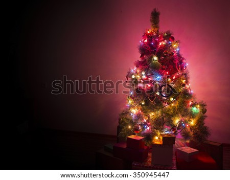 Beautifully decorated Christmas tree with many presents under it. #350945447