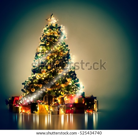 Beautifully decorated Christmas tree with many presents under it. #525434740