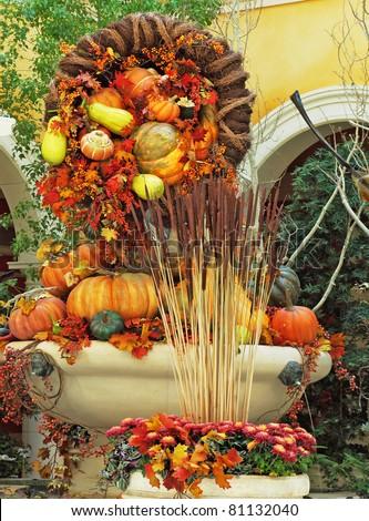 Beautifully decorated lobby luxury hotel. Celebration of harvest: baskets and vases with colorful gourds, flowers and autumn leaves