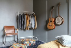 Beautifully designed bedroom with organised clothes