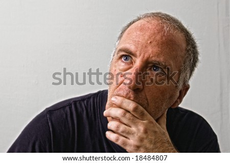 beautifully detailed real portrait of grungy mature adult white man looking up as if listening - stock photo