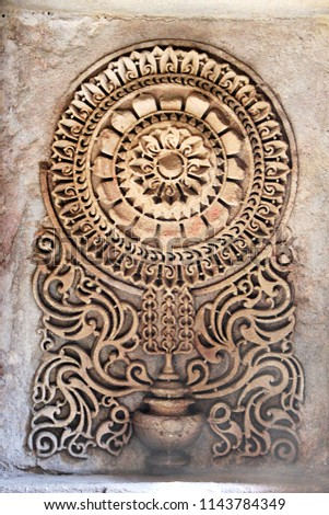Beautifully etched geometrical pattern in mortar at Adalaj Step Well in Ahmedabad, Gujarath, India, Asia #1143784349