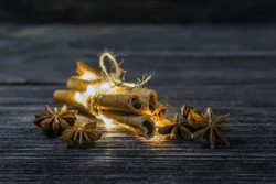 beautifully folded and tied with string and a glowing garland of cinnamon sticks and saffron stars. dreams and wonders of Christmas the aroma of the spices for mulled wine.