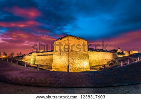 Beautifully illuminated Bahrain Fort before sunrise. Bahrain Fort is part of UNESCO World Heritage.