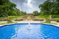 Beautifully landscaped urban rose garden on a cloudy spring day in Texas