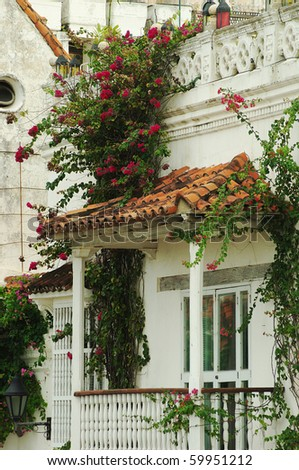 Beautifully ornated balcony with a clamberer in blossom in the historic city center on November 23, 2008 in Cartagena, Colombia.