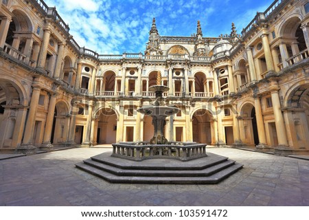 Beautifully preserved castle - palace of the Templars. Courtyard surrounded by galleries. In the center - a fountain with a pool in the shape of a cross. Portugal, Tomar