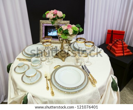 Beautifully served table for banquet and red gift box