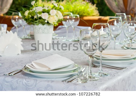 Beautifully served table with roses - stock photo