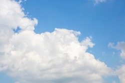 Beautifully spread clouds in the blue and clear sky. High resolution photo editing source for synthetic source