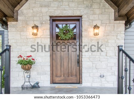 Beautifully symmetric and inviting front exterior door  #1053366473