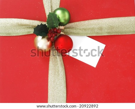 beautifully wrapped gift with gift tag, copy space