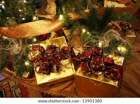 beautifully wrapped xmas presents under xmas tree