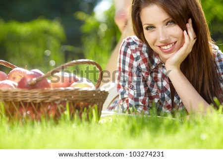 Beautifuwoman  in the garden with apples #103274231