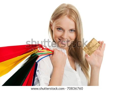 Beautilful young woman carrying shopping bags