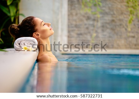 Beauty and body care. Sensual young woman relaxing in outdoor spa swimming pool. #587322731