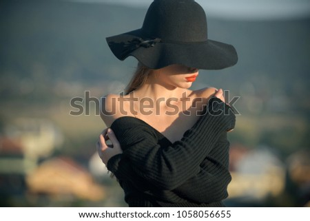 Beauty and fashion. beauty of pretty young woman in black hat. #1058056655